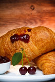 Two cherry croissants Royalty Free Stock Photos