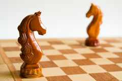 Two chess horses. On chess board Royalty Free Stock Image