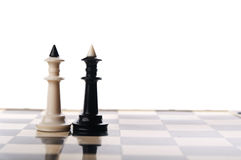 Two chess kings. On black background Royalty Free Stock Images