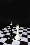 Two chess kings one in front of other. Battle of equal rivals Royalty Free Stock Photo