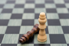 Two Chess Kings with one stands up one lays down Stock Image