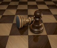Two chess pawn pieces on checkered chess board Stock Photography