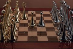 Two chess pawns. The photo shows the chessboard with metal figures Stock Image