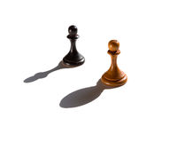 Two chess pawns one casting a bishop piece shadow Royalty Free Stock Images