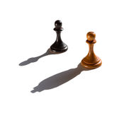 Two chess pawns one casting a king piece shadow Stock Image