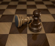 Two chess pieces on checkered board Royalty Free Stock Images