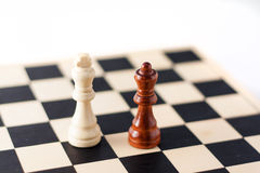 Two chess pieces on the chess board. Stock Photography