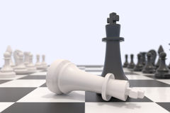 Two chess pieces on a chessboard. White king laying down and black king standing up. Victory, competition, discussion, agreement and confrontation concept. 3D Royalty Free Stock Photography