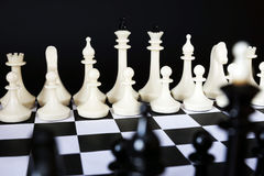 Two chess teams one opposite to other. Concept of coming battle Royalty Free Stock Image
