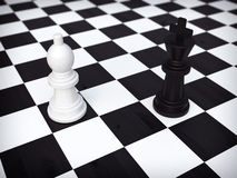 Two chessmans. Standing  on chessboard Stock Image