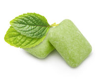 Two chewing gum with mint leaves Stock Photo