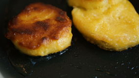 Two chicken nuggets fried in a pan. Close up video stock footage