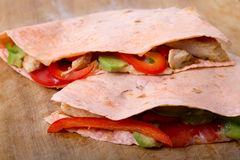 Two chicken quesadillas. Closeup on table royalty free stock images