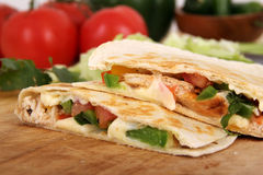 Two chicken quesadillas. On cutting board royalty free stock images