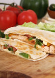 Two chicken quesadillas. On cutting board stock images