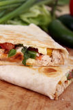 Two chicken quesadillas. On cutting board royalty free stock photo