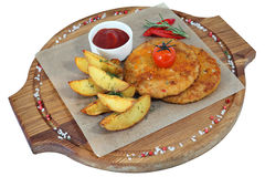 Two chicken rissoles with garnish of potato wedges baked, isolat Stock Photos