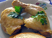 Two  chicken's legs. Chicken's leg on plate Stock Images