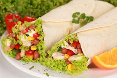 Two Chicken Wrap Sandwiches. Filled with beans, lettuce and corn stock photo