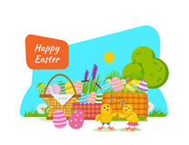 Two chicks frolic and have fun next to Easter basket. Stock Images