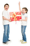 Two child with gift boxes Stock Images