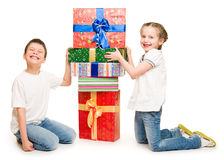 Two child with gift boxes Royalty Free Stock Photography