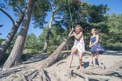 Fun with rope swing Royalty Free Stock Images