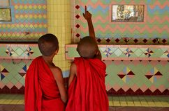 Two child monks in temple of top of Sagaing hill Mandalay Myanmar (Burma) Royalty Free Stock Image