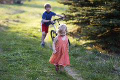 Two children. Running in the meadow Stock Images