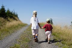 Two children. Outgoing past the horizon Stock Photo