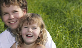 Two children. Portrait smiling on green grass Royalty Free Stock Photos