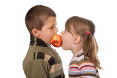 Two children and an apple. On a white background Stock Photography