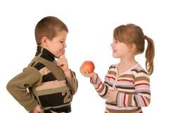Two children and an apple. On a white background Stock Images