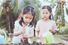 Two children asian little girl having fun to prepare soil Stock Photography