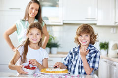 Two children baking fruitcake Royalty Free Stock Photography