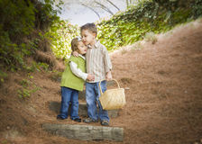 Two Children with Basket Hugging Outside on Steps stock photos