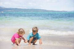 Two children on beach Royalty Free Stock Photos