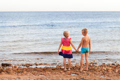 Two children on the beach Royalty Free Stock Images