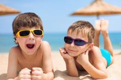 Two children on the beach Stock Image