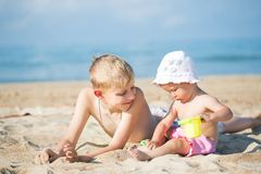Two children on the beach Stock Images