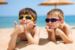 Two children on the beach Stock Photo