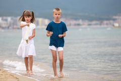 Free Two Children Boy And Girl Walking Barefoot On Sea Shore Water In Summer Stock Photography - 164196792