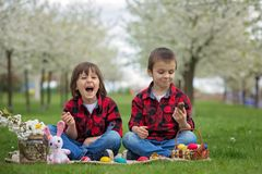 Free Two Children, Boy Brothers, Eating Chocolate Bunnies And Having Stock Photography - 110210382