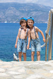 Two children, boy brothers, walking on a path around mediterrane. An sea on French riviera, enjoying sunny summer afternoon Stock Photo