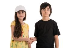 Two children, boy and girl friends posing happily on white backg. Round Royalty Free Stock Photography
