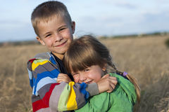 Two children brother and sister hugging Royalty Free Stock Photos