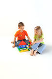 Two children building house Royalty Free Stock Photos