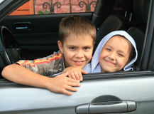 Two children in the car stock image