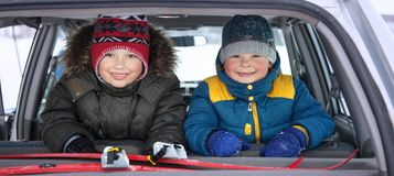 Two children in the car a merry winter trip royalty free stock photo