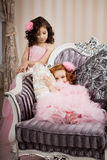 Two children on a chair in a nice dress royalty free stock photography